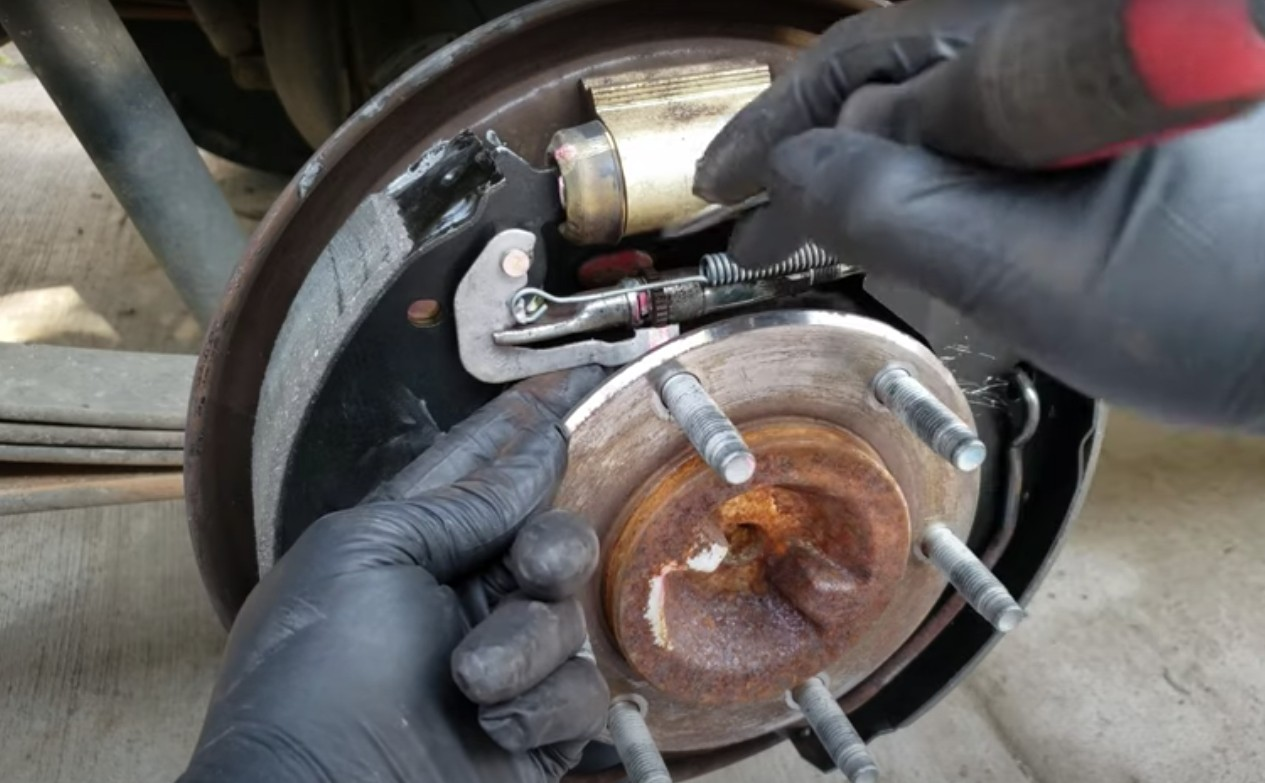 Picture of mechanic doing a rear drum brake job on a truck in Anaheim.