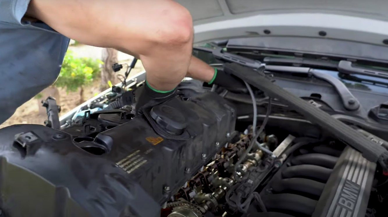Mobile mechanic making mobile auto repair services on a vehicle engine in Anaheim, CA.