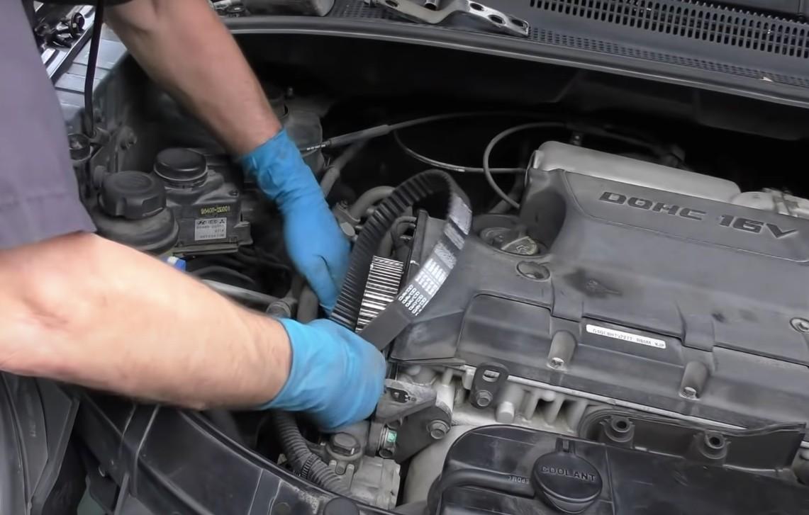 Mobile mechanic changing serpentine belt in Anaheim, CA.